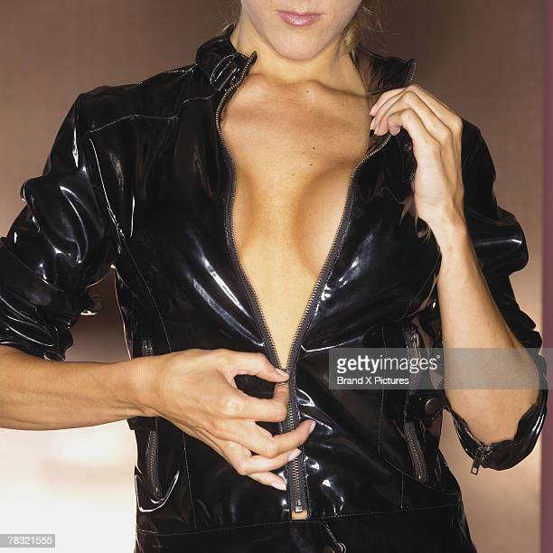 Woman in leather revealing her cleavage