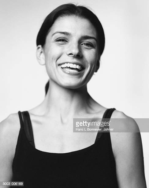 woman in leotard laughing - zwart wit stockfoto's en -beelden