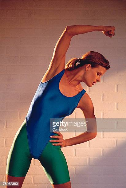 Woman in leotard stretching