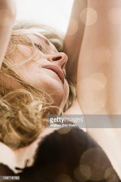 woman in lingerie, arms raised, in ecstasy - orgasmo fotografías e imágenes de stock