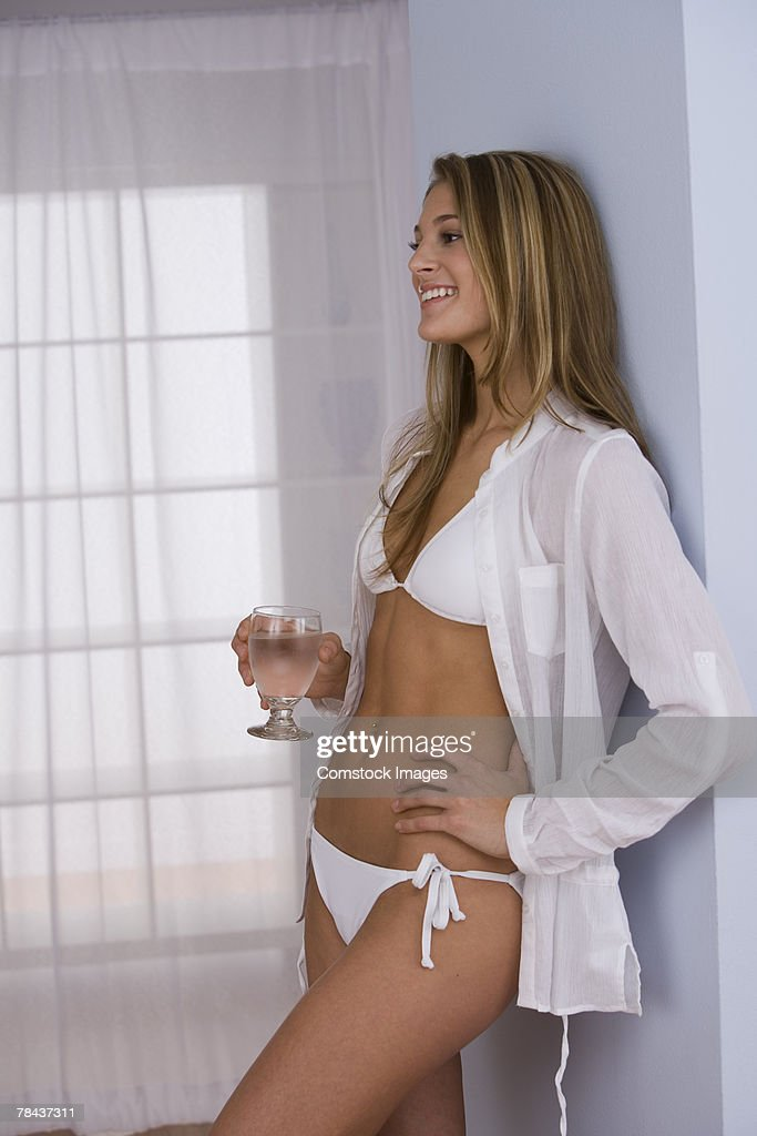 Woman in lingerie drinking water : Stock Photo