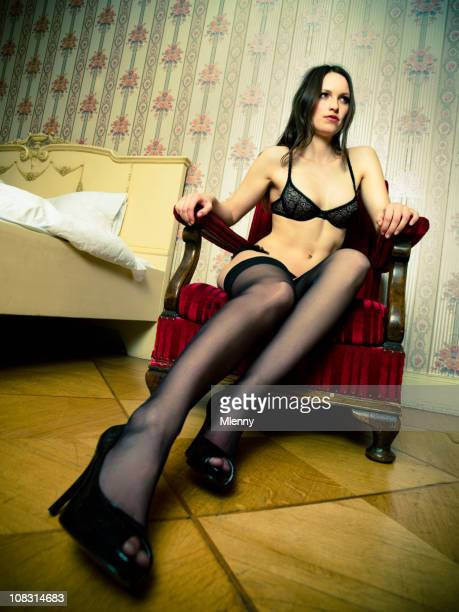 woman in lingerie on red velvet chair. - long nylon legs stock pictures, royalty-free photos & images