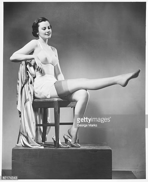 woman in lingerie posing in studio, (b&w), - beautiful legs in stockings stock pictures, royalty-free photos & images
