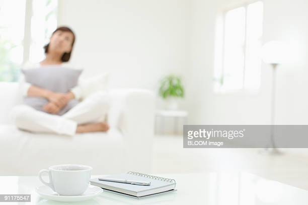Woman in living room, focus on foreground