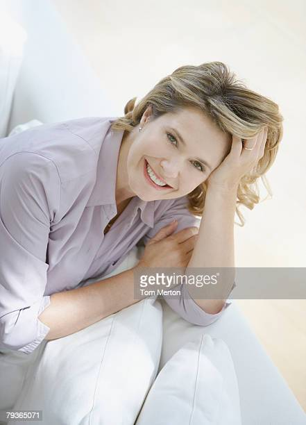 Woman in living room on sofa