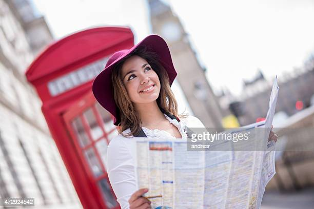 Woman in London holding map