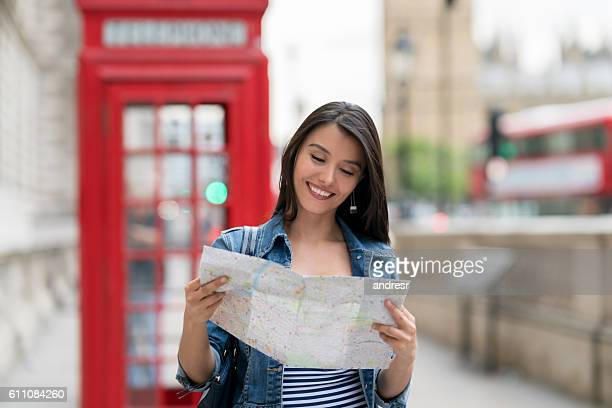 Woman in London looking at a map