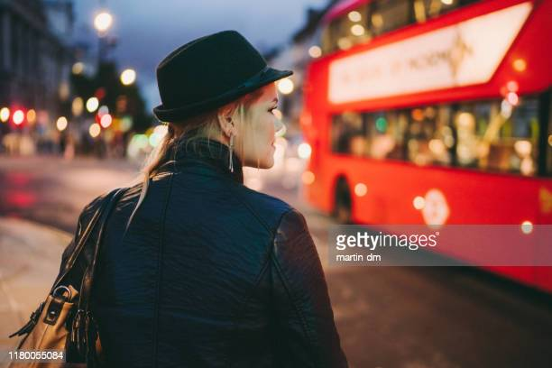 woman in london - shoulder bag stock pictures, royalty-free photos & images