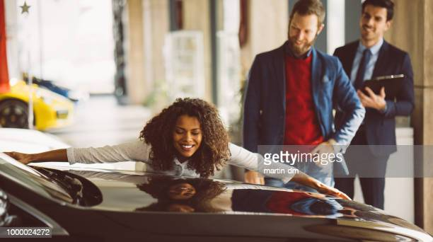 woman in love with new car - buying a car stock pictures, royalty-free photos & images