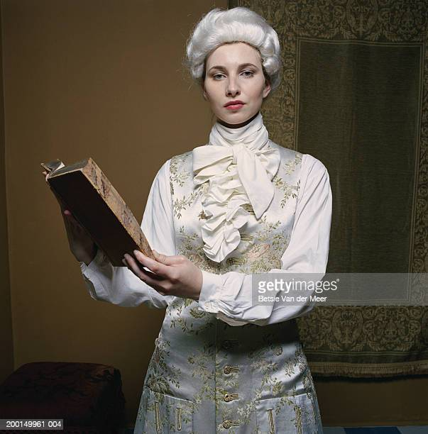woman in male costume from regency era, holding book, portrait - cravat stock pictures, royalty-free photos & images