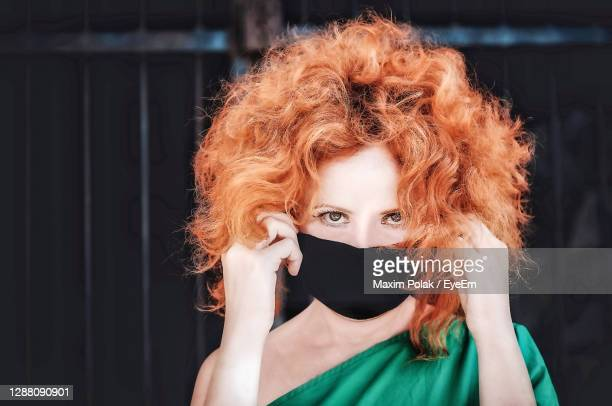 woman in mask from covid-19 - long hair stock pictures, royalty-free photos & images