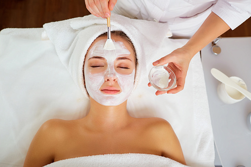 Woman in mask on face in spa salon 902901426