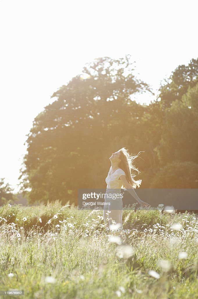 Woman in meadow. : Stock Photo