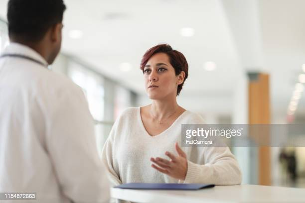 woman in medical consultation - hearing protection stock pictures, royalty-free photos & images