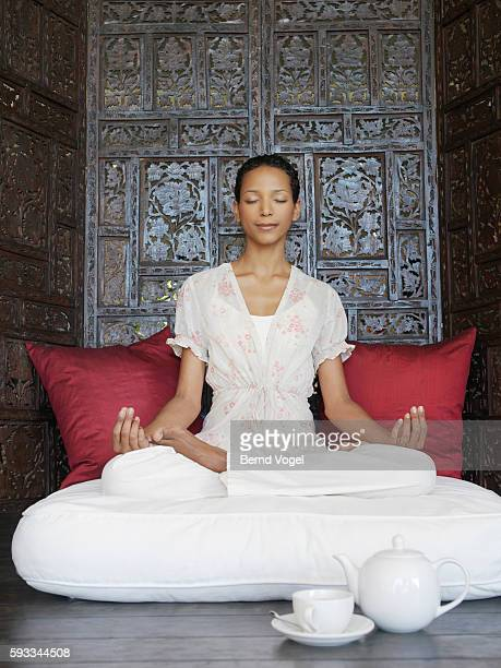 woman in meditation room - cushion stock photos and pictures