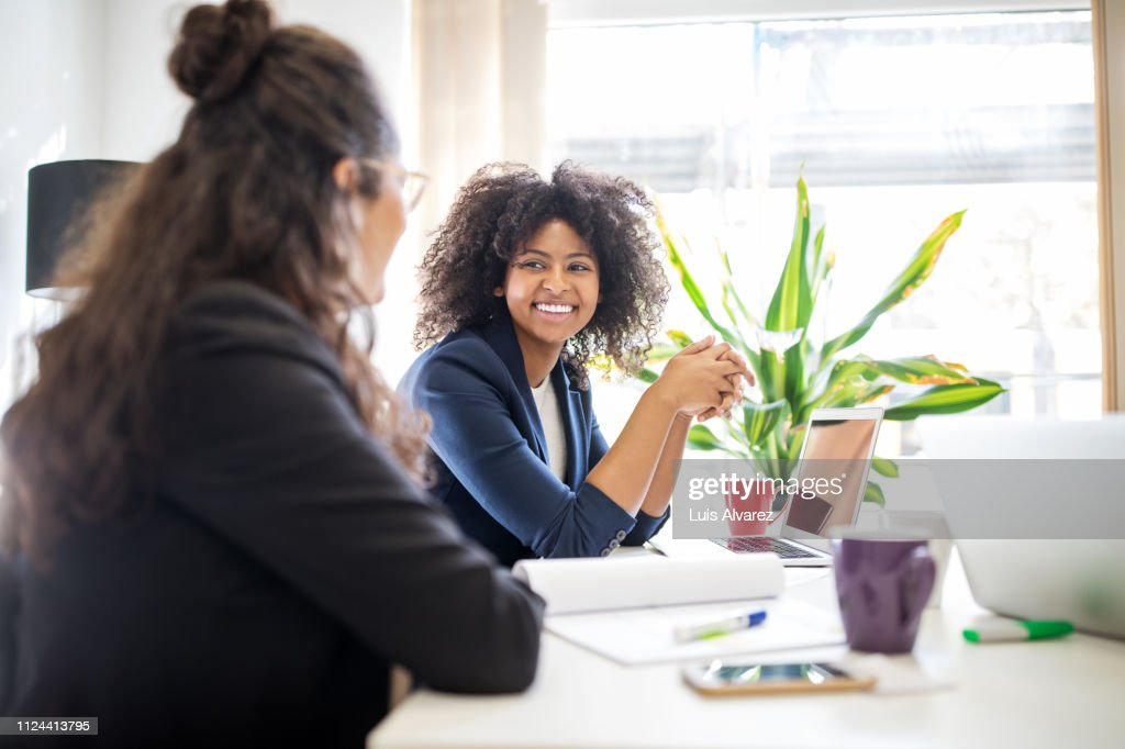 Woman in meeting with coworker at start up office : Stock Photo
