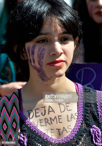 A woman in Mexico City with the sentence 'Stop Looking at my Breasts' written on her chest takes part on October 19 2016 in a march in solidarity for...