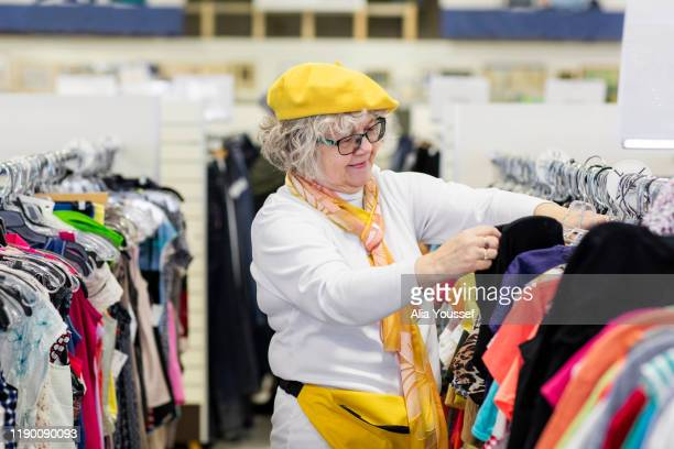 Woman in mid-70s shopping in thrift store