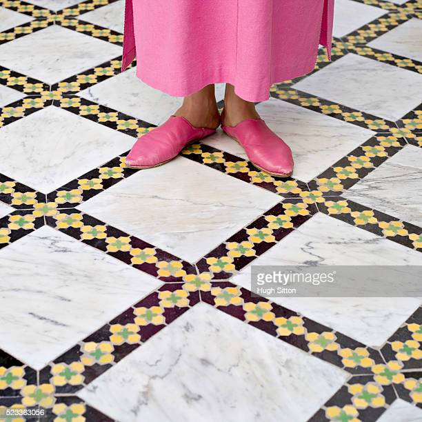Woman in Morrocan Slippers Standing on Mosaic Floor