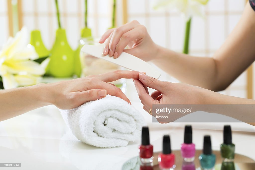 Woman in nail salon receiving manicure : Stock Photo