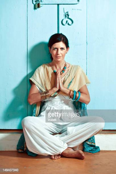 woman in namaste pose - bangle stock pictures, royalty-free photos & images
