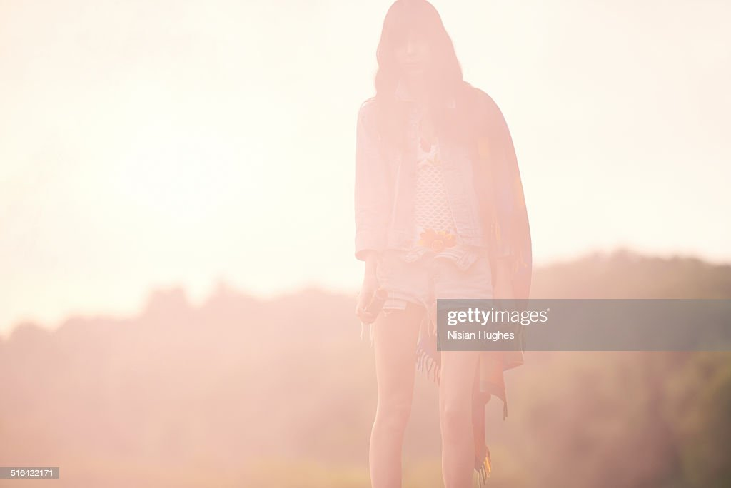 Woman in nature with red mist around her : Stock Photo