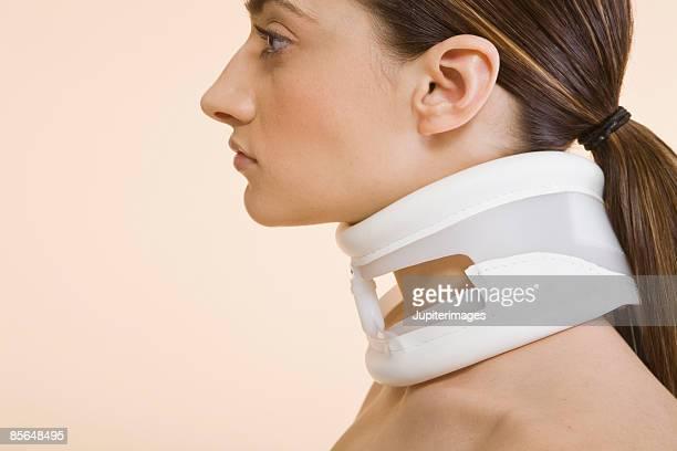 Woman in neck brace
