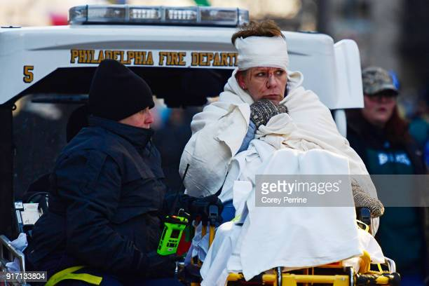 A woman in need of medical attention is carted away during festivities on February 8 2018 in Philadelphia Pennsylvania The city celebrated the...