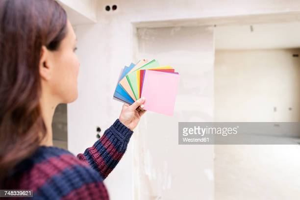 Woman in new home choosing from color sample