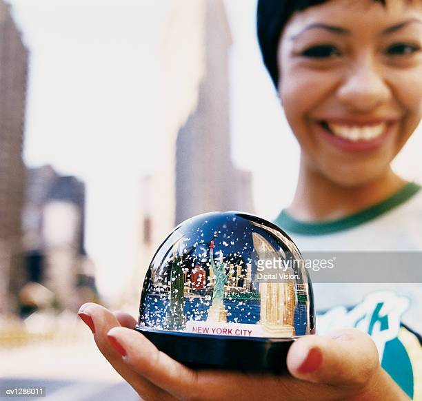 Woman in New York Holding a Snow Globe of the Statue of Liberty