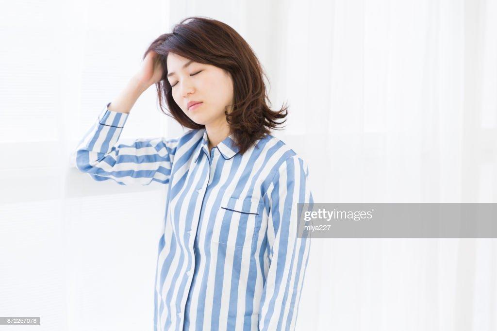 woman in night clothes,glum : Stock Photo