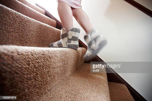 woman in nightgown and slippers walking upstairs - women in slips stock pictures, royalty-free photos & images