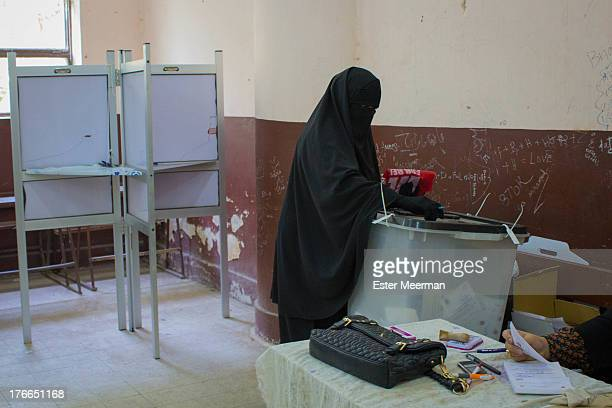 Woman in niqab casts her vote in the second round of the Egyptian presidential elections on the 16th of June 2012.