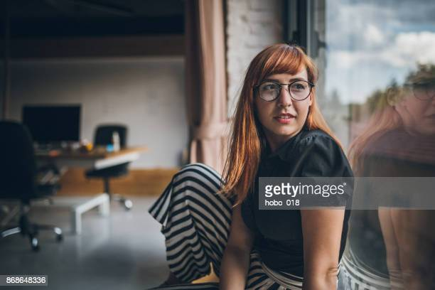 woman in office at break - creative director stock pictures, royalty-free photos & images
