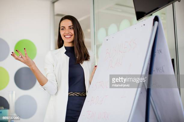 Woman in office holding a presentation