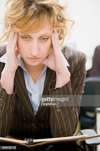 Woman in Office Looking Down