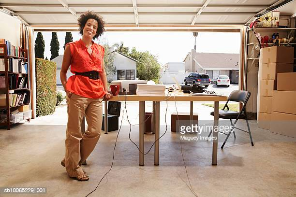 Woman in office space in garage, portrait