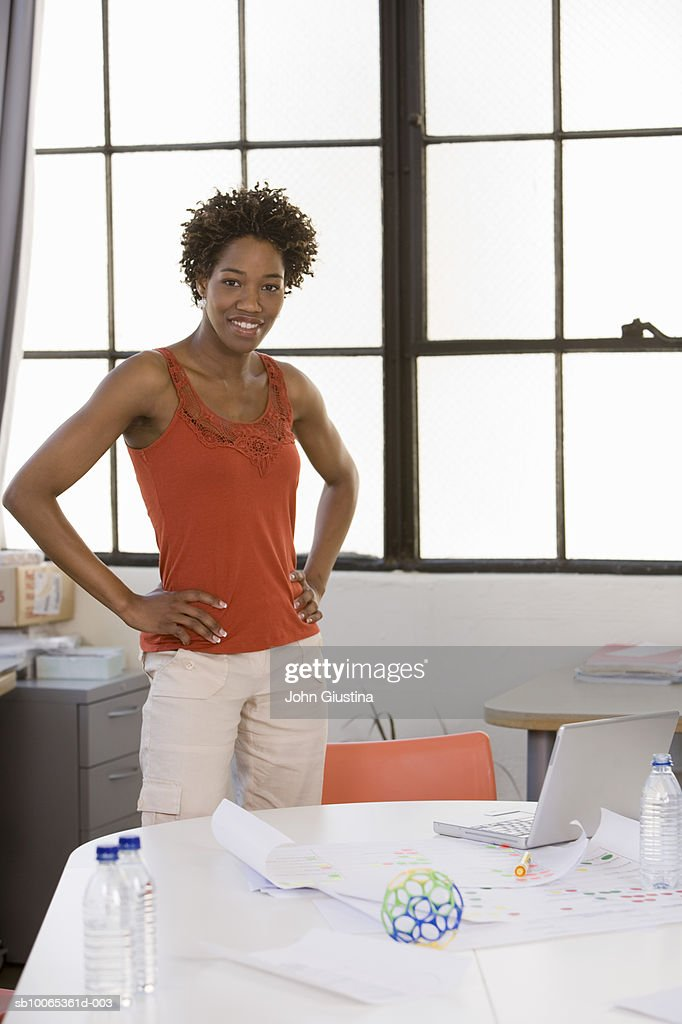 Woman in office standing over plans : Foto stock