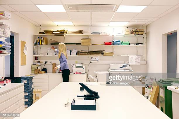 Woman in office storeroom