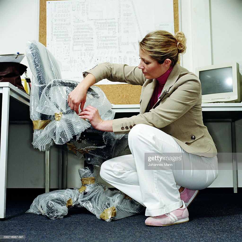 woman office furniture. Woman In Office, Unwrapping Desk Chair Covered Bubblewrap : Stock Photo Office Furniture E