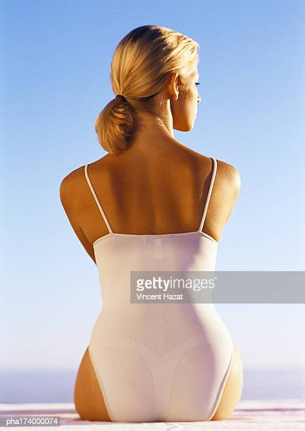Woman in one-piece bathing suit, rear view, close-up