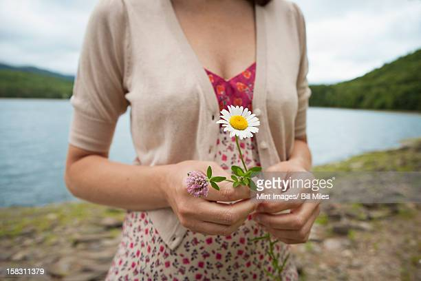 a woman in open countryside, by a mountain lake. - mid section stock photos and pictures