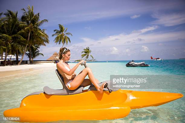 Woman in paddle boat