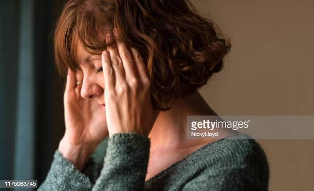 woman in pain - grief stock pictures, royalty-free photos & images