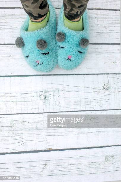 woman in pajama with cozy slippers