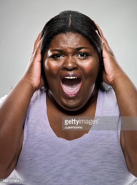 woman in panic - images of fat black women stock photos and pictures