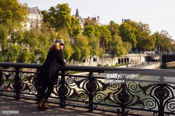woman in paris in autumn - yeowell stock pictures, royalty-free photos & images
