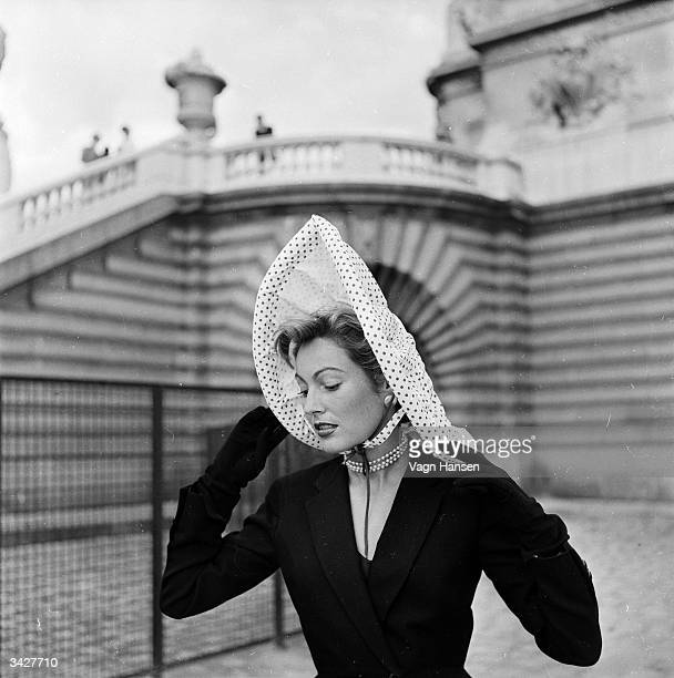 Woman in Paris modelling one of Monsieur Andre's inflatable Miracle hats, which are not only waterproof but can be deflated to fit inside a handbag.