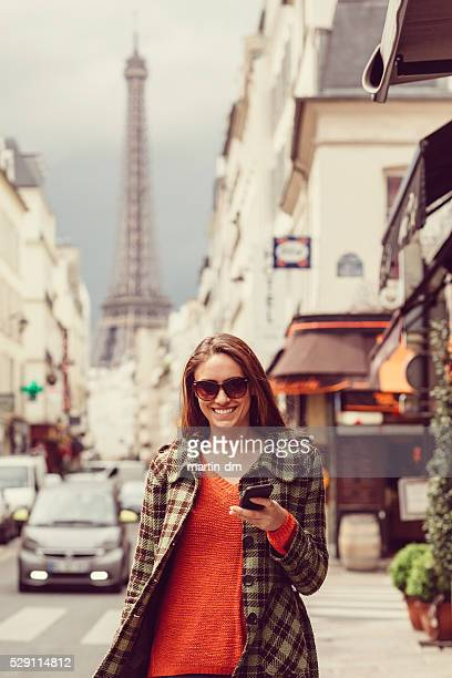 Woman in Paris text messaging