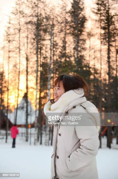 Woman In Park In Winter